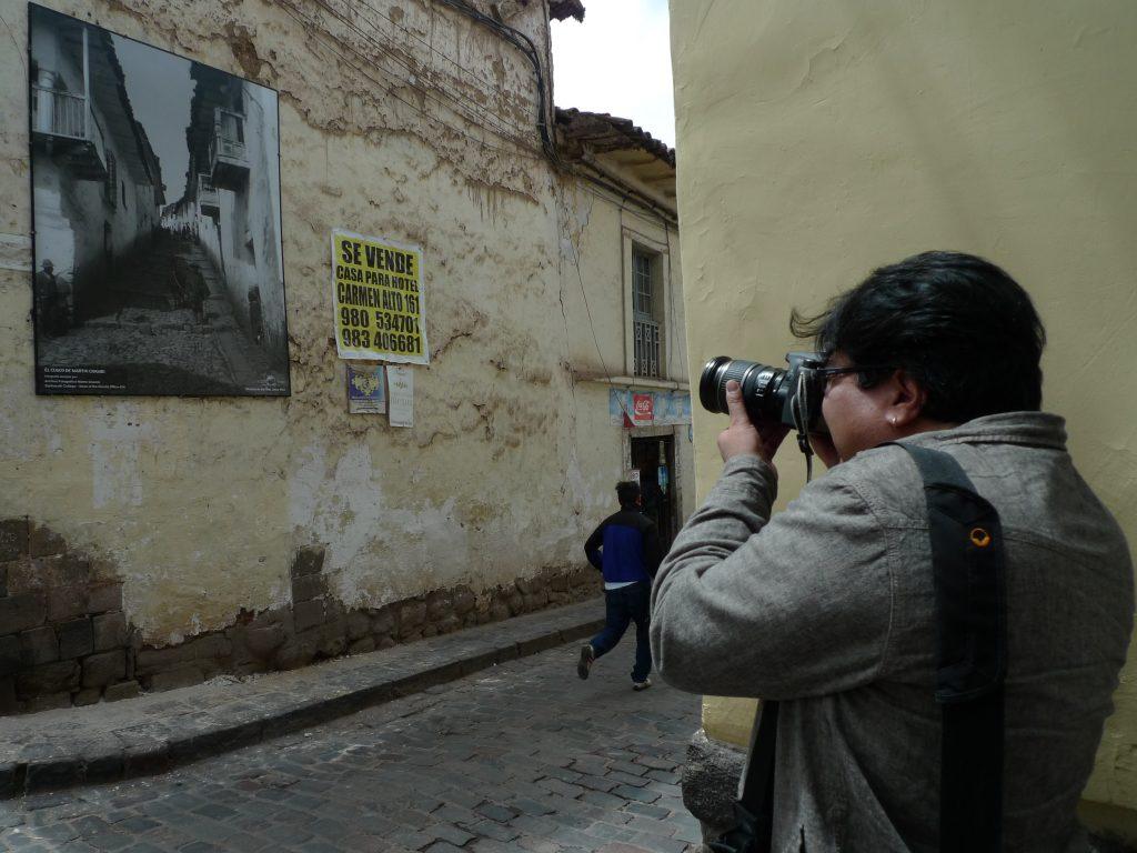 Julio Pantoja photographing exhibit. Photo: Silvia Spitta, 2014.